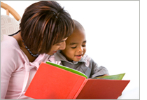 Parent reading personalized book to her child
