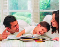 Parents and child reading together