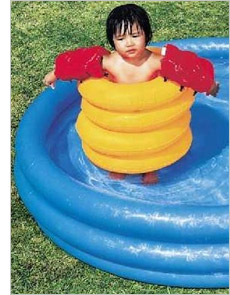 Overprotected child in paddling pool