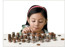 Young girl counting her money
