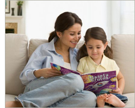 Mother and child reading Little Heroes personalized children's book in Spanish